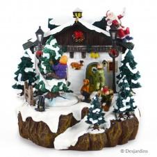 Les enfants et le père Noël jouent devant la maison Luville