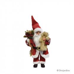 Père Noël debout avec...